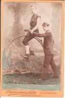 """Racing cyclist and his """"Starter"""" Circa 1883"""